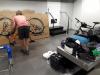 Op Schiphol; fietsen in de dozen doen/ putting bikes in the boxes at the airport